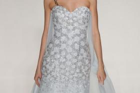 A model walks the runway wearing a Frozen-inspired wedding gown from the Disney Fairy Tale Weddings by Alfred Angelo Collection at EZ Studios on October 8, 2014 in New York City.
