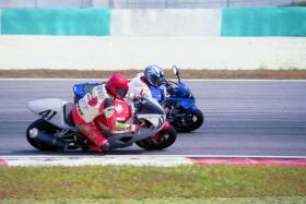 Sport bike riders with their Honda RVSs and Suzuki GSXs head to Malaysian tracks to put their lean machines to the test.