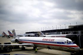 An American Airlines plane. A man risks up to 20 years in a US prison for losing his cool when a passenger reclined a seat on a flight from Miami to Paris.