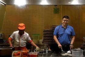 HALAL: (Above, right) Mr Tan Kim Leng at his restaurant Encik Tan, which serves dishes such as fried carrot cake  and popiah.