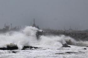 In this photograph taken on Oct 11, 2014 large waves buffet the coastline ahead of Cyclone Hudhud making expected landfall in Visakhapatnam. India placed its navy on high alert and evacuated around 350,000 people from eastern coastal areas as it prepared for a severe cyclone to hit on Oct 12.