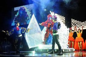 GRAND ENTRANCE: Getai veteran Liu Lingling (above) burst out of a giant 'rice dumpling' during the show's opening number.