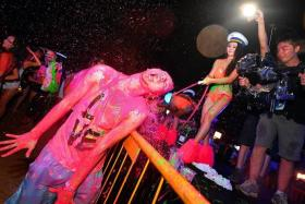 COLOURFUL: Illumi Nation, the glow-in-the-dark paint party at Sentosa on Saturday, lasted from 6pm till 3am.