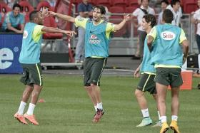 DANCING DUO: Robinho (left) and Kaka (centre) show off Brazil's samba style during training yesterday.