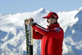 Picture taken on January 17, 2003 shows Formula one World champion Ferrari driver Michael Schumacher holding his skis before a giant slalom race in Madonna di Campiglio, Italy.