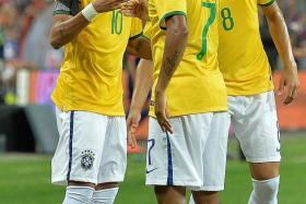 """""""He's our new captain, and he's enjoying his football, and he's playing like he plays when he's with his friends."""" — Brazil coach Dunga, on Neymar (above left, celebrating with Robinho)"""