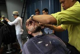 TRIMMING FOR GOOD TIDINGS? Warriors coach Alex Weaver getting groomed at the Sultans of Shave on Wednesday. The barber shop has inked a one-year deal worth $25,000 with the S.League giants.
