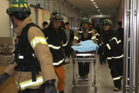 Fourteen people were killed at a open-air pop concert in South Korea on Friday when the cover of a ventilation shaft they were standing on gave way, officials and media said.