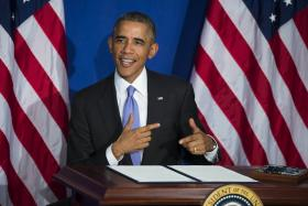 US President Barack Obama tells a story about his credit card was recently declined at a restaurant, after signing an Executive Order to implement enhanced security measures on consumers' financial security at the Consumer Financial Protection Bureau (CFPB).