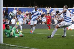 CALAMITY: QPR's Richard Dunne (right) scoring an own goal which gave Liverpool the lead.