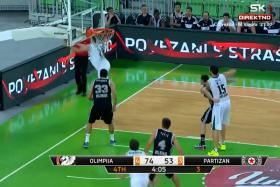 Union Olimpija Ljubljana basketballer Blaz Mahkovic (jumping) recovers a teammate's missed shot to score from behind the net.