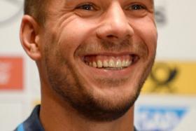 Arsenal forward Lukas Podolski has shot down a transfer rumour linking him to Spurs on Twitter.
