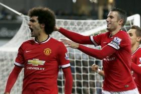Marouane Fellaini celebrating his first goal for Manchester United.