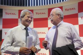 Chief executive officer of French oil group Total, Christophe de Margerie, (R) at the Total stand at the Paris Auto Show on Oct 2, 2014.