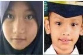 Nur Azdriana (left) and Yunis drowned after ignoring their parents' warning to swim in the pond.