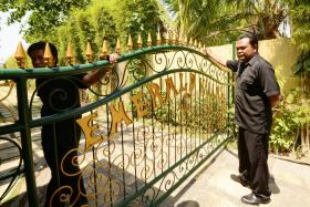 Security guards standing at the front gate of Emerald villas in Sanur on Bali island on Wednesday.