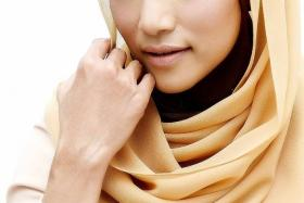 OLD AND NEW: (Main) Ziana Zain now wears the hijab. (Above) Ziana on the cover of Sutra magazine August 2012 issue.
