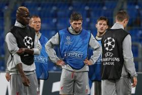 POOL PROBLEMS: Steven Gerrard (centre) looks past his best, while Mario Balotelli (left) has failed to deliver the goals.