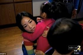 Liu with her four-year-old daughter. Screengrab WSBTV