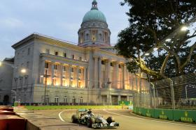 Mercedes driver Lewis Hamilton of Britain steers his car on the Marina Bay Street circuit during the third practice session of the Formula One Singapore Grand Prix on Sept 20, 2014.