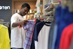 CELEBRATIONS: Mr Anand Atti Gadda shopping for new clothes for Deepavali.