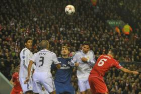 Real Madrid's Portuguese forward Cristiano Ronaldo (2R) defends against Liverpool's Croatian defender Dejan Lovren (R) with Real Madrid's Spanish goalkeeper Iker Casillas (C) during the UEFA Champions League, group B, football match.