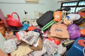 FILLED: (Above) Mr Tony Seah's living room, kitchen and toilet before the clean-up.