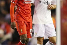 BEFORE: Balotelli consoled by Pepe at half-time.