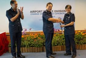 SAC Zuraidah (R) taking over the Command Sword from the Commissioner of Police Ng Joo Hee.