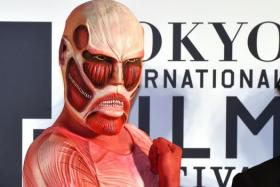 A character from Japanese manga Attack on Titan poses on the red carpet for the 27th Tokyo International Film Festival opening ceremony in Tokyo on October 23, 2014.