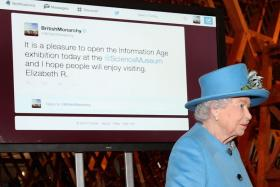 Queen Elizabeth sends her first tweet during a visit to open the Information Age exhibition at the Science Museum in London.