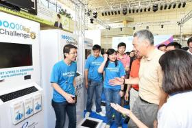 WEIGHING IN:Prime Minister Lee Hsien Loong at a Million Kg Challenge weigh-in kiosk yesterday.