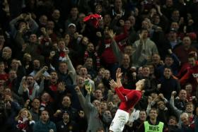 Robin van Persie throws his shirt into the air in celebration after scoring Manchester United's equalising goal against Chelsea.