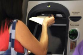 Two POSB ATMs were splashed with paint over the weekend.
