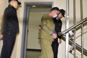 Lee Joon Seok, captain of the sunken ferry Sewol, arriving at a court in Gwangju on Monday. South Korean prosecutors sought the death penalty for the captain.