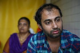 GRIEF: (Above) Mr Nimit Shah is devastated by his wife's death. His mother-in-law is in the background.