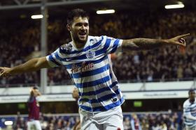 Queens Park Rangers' Charlie Austin celebrates his second goal against Aston Villa during their English Premier League soccer match at Loftus Road in London, October 27, 2014.