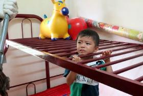 Mohd Amirul, four, had to endure 25 minutes of agony before he was freed by firemen.