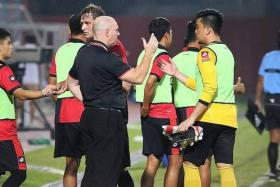 IN DRIVER'S SEAT: DPMM coach Steve Kean (in black) congratulating his players after their victory last night.