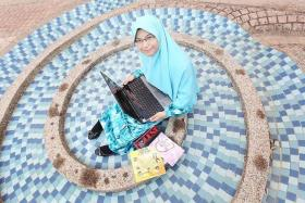 INTELLIGENT: Miss Majiidah Khamsani came from a family that often competed in Quran recital competitions.