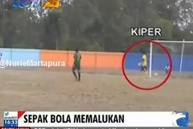 YouTube screenshot of a news report showing a goalkeeper failing to stop an own goal being scored during an Indonesian Premier Division football match.