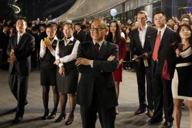 SOHO China Chairman Pan Shiyi (in front) with his staff and guests at an inauguration ceremony to mark the opening of Wangjing SOHO, in Beijing, last month.