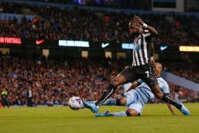 OUT YOU GO: Newcastle midfielder Moussa Sissoko's (No. 7) goal against Man City yesterday made it 2-0 and ended the Citizens' defence of the League Cup.