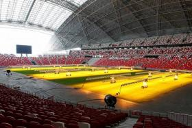 SATISFIED: AFF's independent field expert Hiroi Koichi, FAS director of marketing and communications Gerard Wong and Sports Hub's managing director of facilities management Eric Tan after inspecting the National Stadium pitch (above) yesterday.