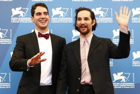 Directors Josh (right) and Benny (left) Safdie pose at the 71st Venice Film Festival in August.