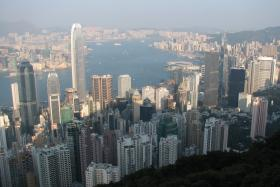 A British financier has been arrested on suspicion of murder after two women were found dead inside his luxury apartment in Hong Kong.