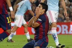 Barcelona's Luis Suarez reacts after missing a goal against Celta Vigo during their Spanish first division soccer match at Camp Nou stadium in Barcelona Nov 1, 2014.