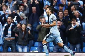 GOAL MACHINE: Man City striker Sergio Aguero celebrating his 10th goal of the EPL season yesterday.