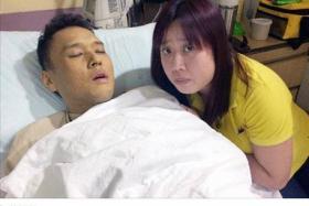 Mrs Serene Koh by her ailing husband Jason Mah's bedside.