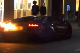 Screenshot of a video showing a Lamborghini Aventador on fire after it was over-revved by its driver.